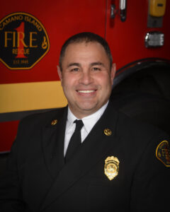 A photo of a firefighter in class A uniform